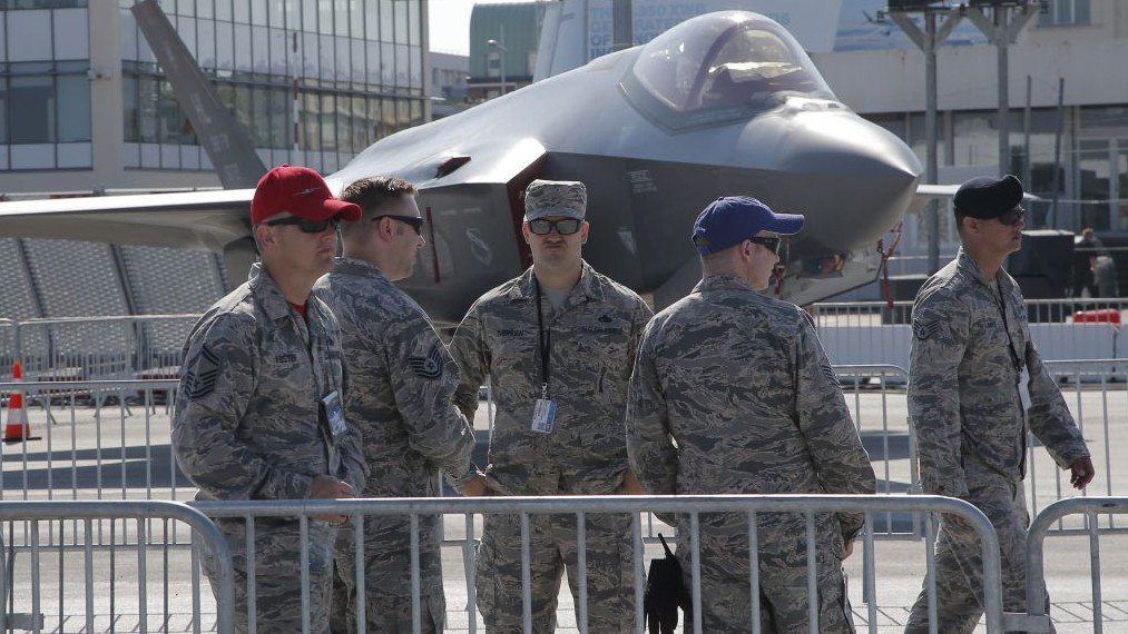 U.S. servicemen gather next to a F-35 Lightning II at Paris Air Show, on the eve of its opening, in Le Bourget, east of Paris, France, Sunday, June 18, 2017. (AP/Michel Euler)