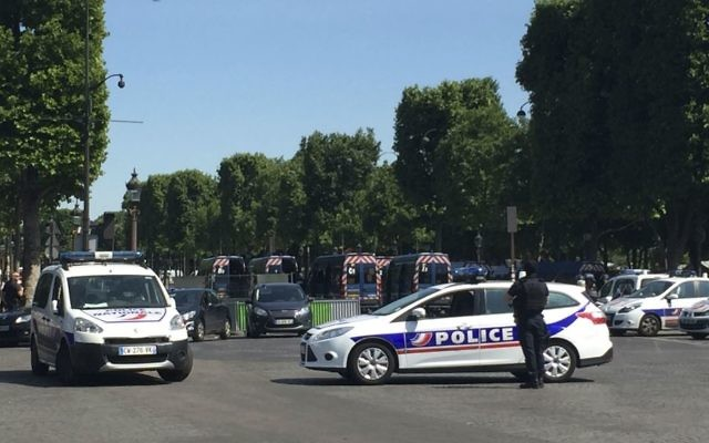 Police vehicles prevent access to the Champs Elysees avenue in Paris, France, Monday, June 19, 2017. (AP Photo/Bertrand Combaldieu)
