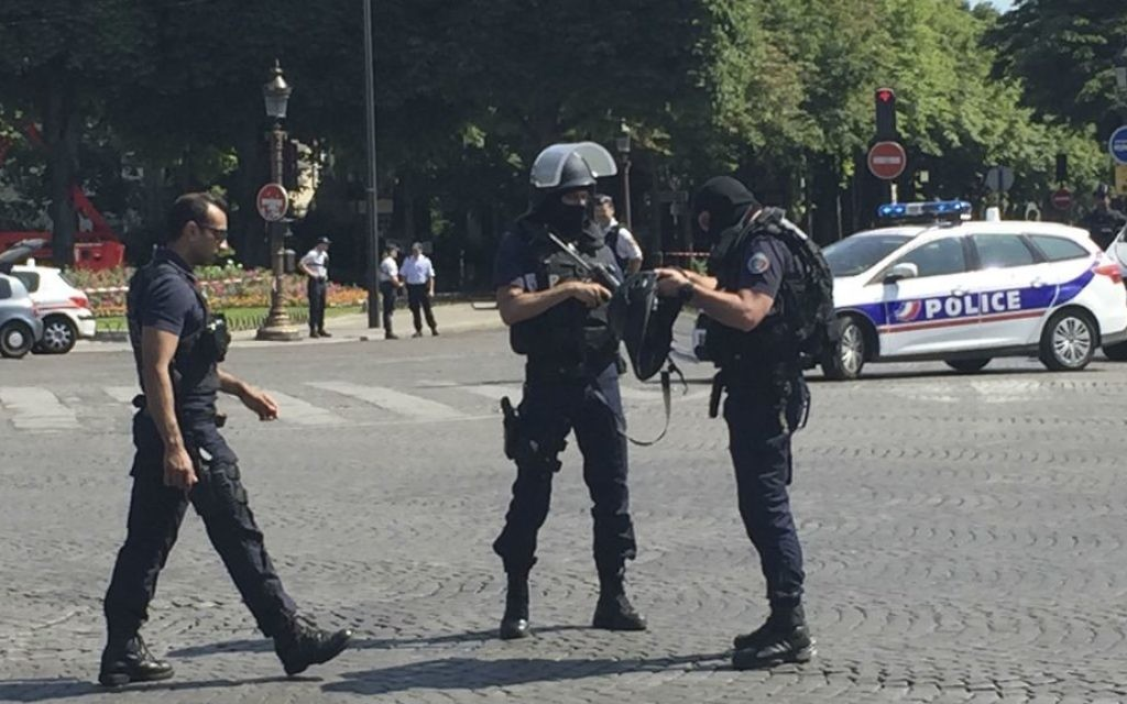Police officers seal off access to the Champs Elysees avenue in Paris, France, Monday, June 19, 2017. (AP Photo/Bertrand Combaldieu)