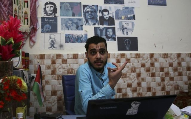 In this Tuesday, May 30, 2017 photo, activist Mohammed al-Taluli speaks to The Associated Press, at his family house in Beit Lahiya, Gaza Strip (AP Photo/Adel Hana)