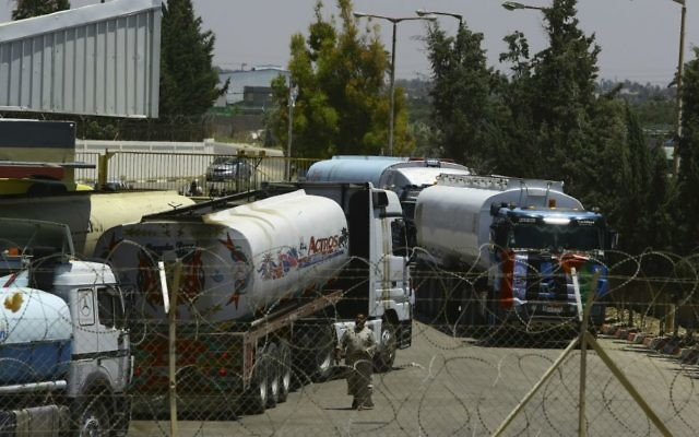 Egyptian fuel trucks parked inside the Gaza power plant in Nusseirat, in the central Gaza Strip, Wednesday, June 21, 2017. (AP Photo/Adel Hana)