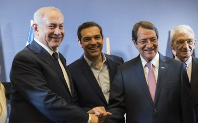 Prime Minister Benjamin Netanyahu, left, Greek Prime Minister Alexis Tsipras, center, and Cypriot President Nicos Anastasiades shake hands during their meeting in Thessaloniki, Greece's second largest city, on June 15, 2017. (AP Photo/Giannis Papanikos)