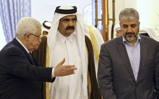 In this Feb. 6, 2012 photo, then-Emir of Qatar, Sheikh Hamad Bin Khalifa Al-Thani, center, Palestinian President Mahmoud Abbas, left, and then-Hamas leader, Khaled Mashaal, arrive to sign an agreement in Doha, Qatar. (AP Photo/Osama Faisal)