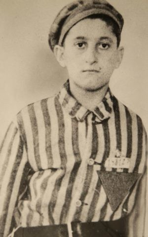 In this undated World War II-era photograph provided by Many Hats Productions, Holocaust survivor Steve Ross wears a Nazi prison camp uniform. (courtesy of the family via Many Hats Productions via AP)