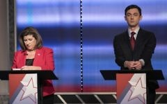 In this June 6, 2017 photo, candidates in Georgia's 6th Congressional District race Republican Karen Handel, left, and Democrat Jon Ossoff prepare to debate in Atlanta. (Branden Camp/Atlanta Journal-Constitution via AP)
