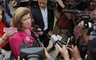 Karen Handel, Republican candidate for Congress, talks to the press Tuesday, June 20, 2017, after she voted in the 6th District Special Election at St Mary's Orthodox Church in Roswell, Ga. (Bob Andres/Atlanta Journal-Constitution via AP)
