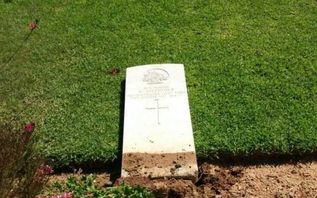 A photo of a headstone toppled by vandals in the Beersheba War Cemetery on 17 June 2017. (Israel Police)