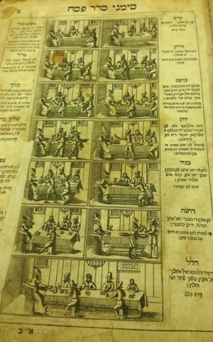 A wine-stained page from the ancient haggadah in the Schneerson Collection. (Courtesy)
