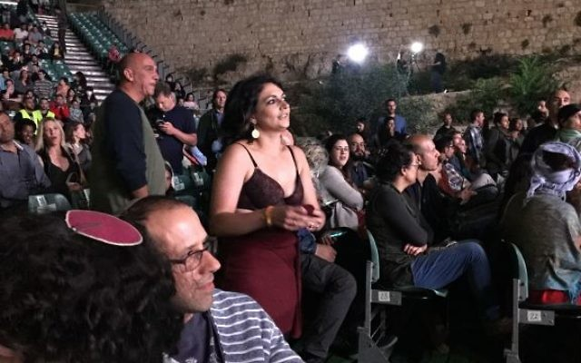 A woman, center, strips down to her bra in a show of protest to Culture and Sports Minister Miri Regev during the opening of the Israeli Film Festival in Jerusalem, June 1, 2017. (Jessica Steinberg/Times of Israel)