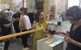 Customers browsing at Parallel, a studio and shop run by three designers in Jerusalem's Beit Alliance (Jessica Steinberg/Times of Israel)