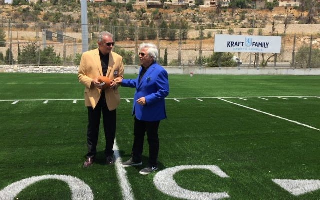 New England Patriots owner Robert Kraft (right) with NFL Hall of Fame member Joe Montana at the Kraft Family Sports Campus inaugurated in Jerusalem in 2017 (Jessica Steinberg/Times of Israel)