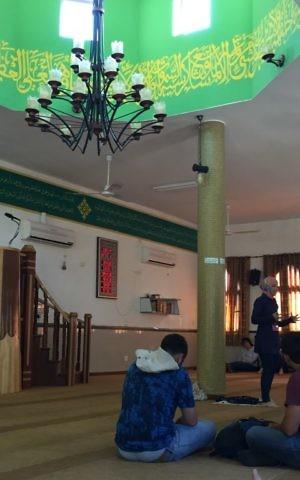 Ramadan Nights guide Shireen Mahajna explains the five pillars of Israel an Umm al-Fahm mosque on June 22, 2017. (Amanda Borschel-Dan/Times of Israel)