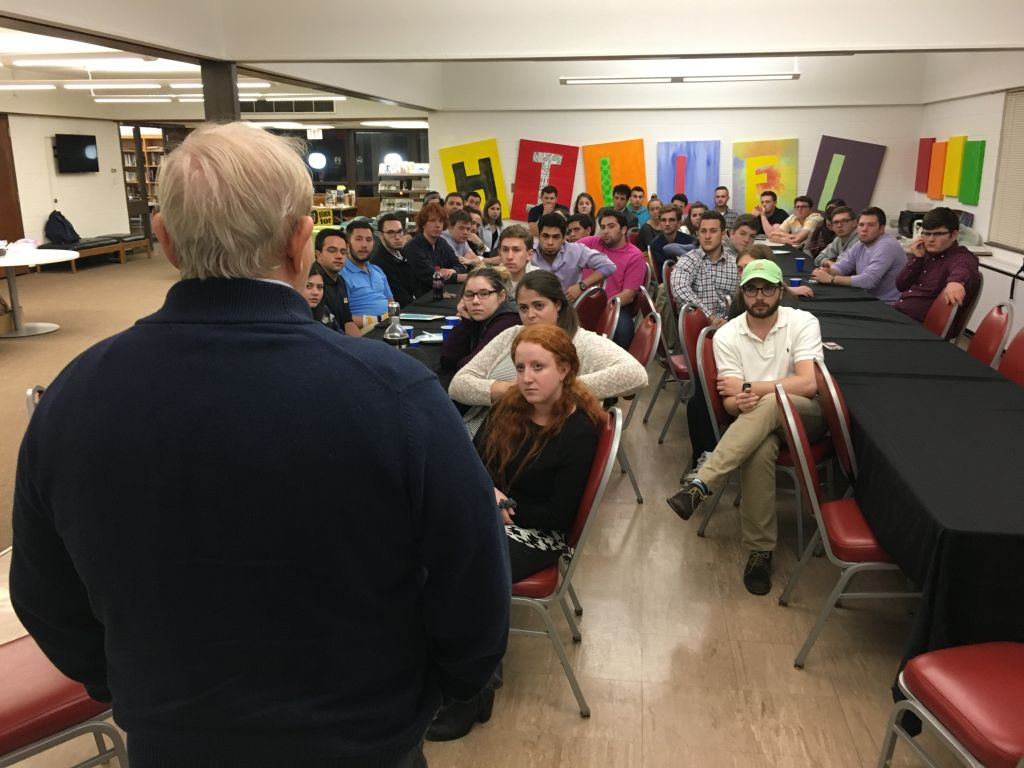 Michael Bornstein speaks to students in an Iowa Hillel House about his experiences surviving Auschwitz. (Courtesy)