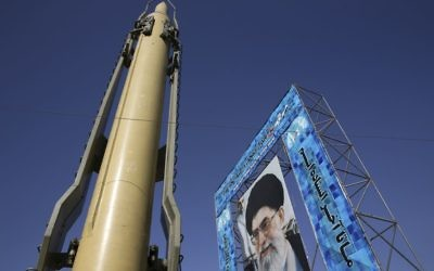 A Ghadr-F missile is displayed next to a portrait of Iranian Supreme Leader Ayatollah Ali Khamenei at a Revolutionary Guard hardware exhibition marking the 36th anniversary of outset of Iran-Iraq war, at Baharestan Sq. in downtown Tehran, Iran, on Sunday, September 25, 2016. (AP/Vahid Salemi)