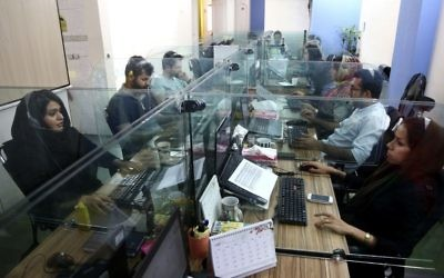 In this Sunday, May 22, 2017, photo, order processors of the Bamilo online shopping site work at their office in Tehran, Iran. (AP Photo/Ebrahim Noroozi)