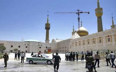 Police officers control the scene, around of shrine of late Iranian revolutionary founder Ayatollah Khomeini, after an assault by several attackers in Tehran, just outside Tehran, Iran, Wednesday, June 7, 2017.   (AP Photo/Ebrahim Noroozi)