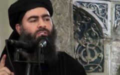 Abu Bakr al-Baghdadi delivering a sermon at Mosul's al-Nuri mosque in Iraq during his supposed first public appearance, July 5, 2014. (AP Photo/Militant video, File)