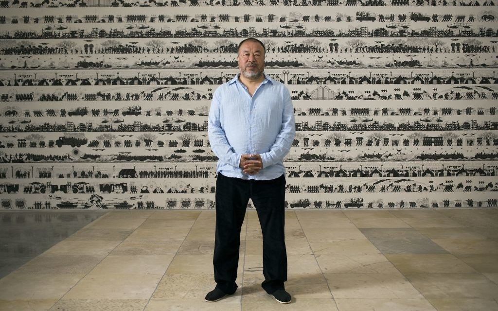Chinese artist Ai Weiwei poses before the opening of his exhibition in the Israel Museum in Jerusalem, Thursday, June 1, 2017. (AP Photo/Dan Balilty)