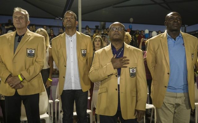 In this Thursday, June 15, 2017 photo, former NFL players, from left, Joe Montana, Andre Reed, Mike Singletary and Bruce Smith attend a football game in Ramat Hasharon, near Tel Aviv, Israel. (AP Photo/Tsafrir Abayov)