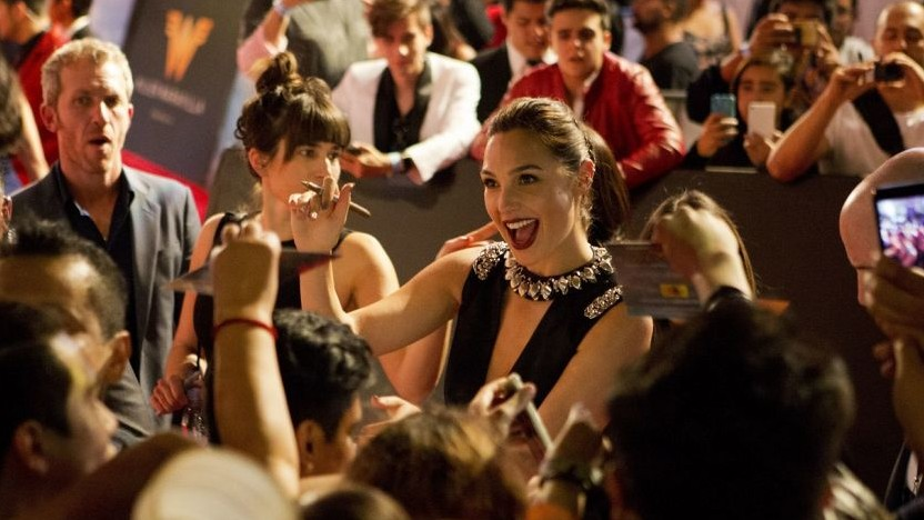 In this May 27, 2017 file photo, actress Gal Gadot signs autographs and greets fans during the Latin American premiere of the film 'Wonder Woman' in Mexico City (AP Photo/Rebecca Blackwell, File)