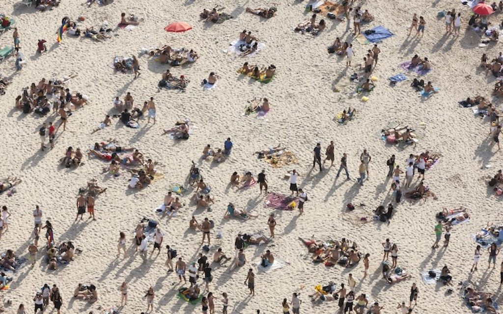 Tel Aviv's beaches -- as seen in 'Tel Aviv Beach' by Itamar Grinburg -- will open early for the season, just in time for Passover. (Courtesy of Karen Lehrman Block)