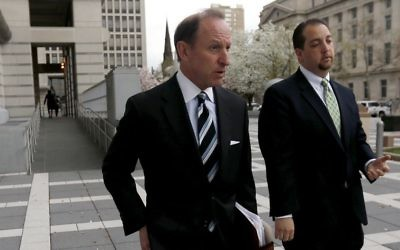 In this April 22, 2015, file photo, Abbe Lowell (L) walks out of Martin Luther King Jr. Federal Court following a pretrial hearing for his client Sen. Bob Menendez in Newark, New Jersey. (AP Photo/Julio Cortez, File)