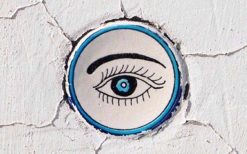 Jewish design identity: Keeping Away the Evil Eye - A ceramic amulet at the entrance door of a house. 29 Shabazi Street. Nahalat Achim Neighborhood. (Courtesy)