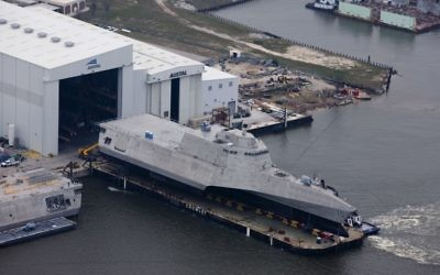 An aerial view of the US Navy littoral combat ship USS Gabrielle Giffords (LCS-10) during its launch sequence at the Austal USA shipyard, Mobile, Alabama, February 24, 2015.  (U.S. Navy photo, public domain)