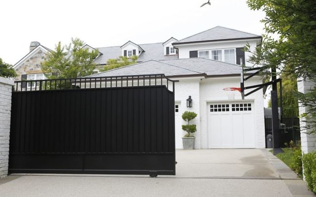 The freshly repainted front gate of a home belonging to Cleveland Cavaliers' LeBron James, May 31, 2017. (AP Photo/Damian Dovarganes)