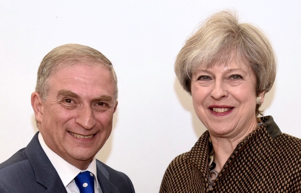 Lee Scott with British Prime Minister Theresa May. (Courtesy)
