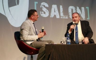 Defense Minister Avigdor Liberman, right, speaks with journalist Matthew Kalman at an event organized by The Times of Israel and the Tel Aviv International Salon at the Tel Aviv port on June 15, 2017. (Judah Ari Gross/Times of Israel)