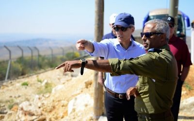 Retired US vice admiral Peter Neffenger, left, speaks with Brig. Gen. (res.) Ronen Simchi, a former fighter pilot and air force commander, during a visit to Israel with the Jewish Institute for National Security of America in June 2017. (IDF Spokesperson's Unit)
