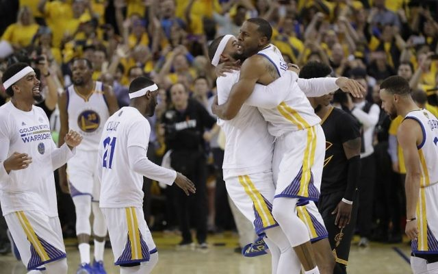 Golden State Warriors players celebrate after beating the Cleveland Cavaliers in Game 5 of basketball's NBA Finals in Oakland, California, June 12, 2017. (AP Photo/Marcio Jose Sanchez)
