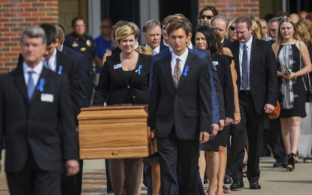 The casket of Otto Warmbier is carried from Wyoming High School after his funeral, Thursday, June 22, 2017, in Wyoming, Ohio. (AP Photo/Bryan Woolston)