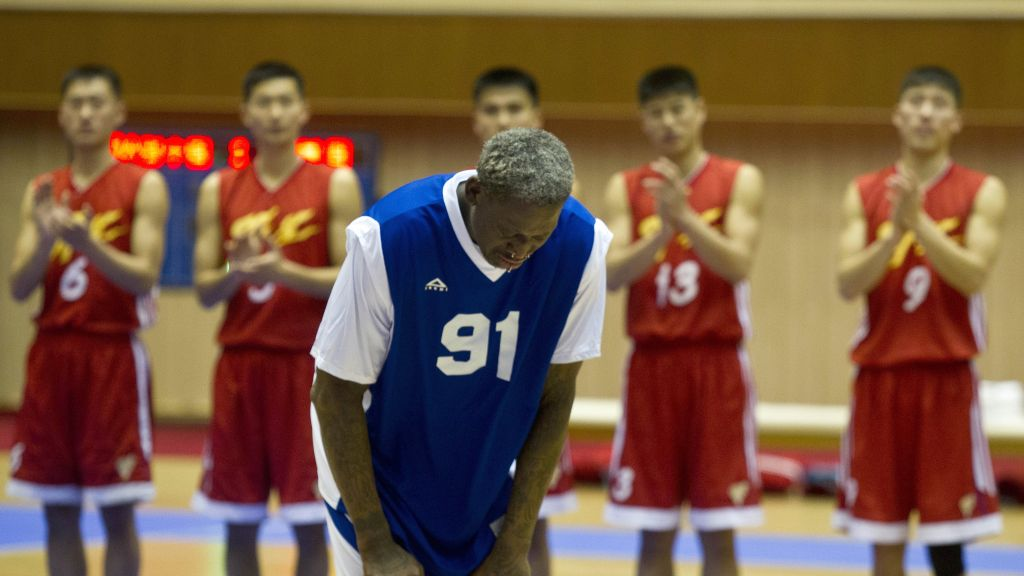 In this Jan. 8, 2014, photo, Dennis Rodman bows to North Korean leader Kim Jong Un, seated above in the stands, after singing Happy Birthday to Kim before an exhibition basketball game with US and North Korean players at an indoor stadium in Pyongyang, North Korea. (AP Photo/Kim Kwang Hyon)