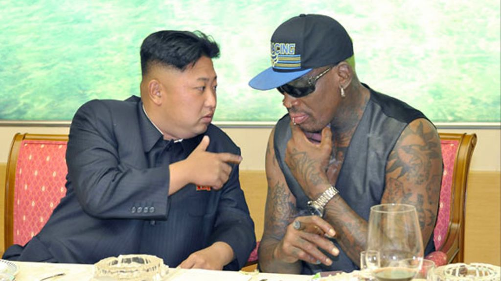 In this undated photo published on Sept. 7, 2013, on the homepage of North Korea's Rodong Sinmun newspaper, North Korean leader Kim Jong Un, left, talks with former NBA player Dennis Rodman during a dinner in North Korea. (Rodong Sinmun/Korea News Service via AP)