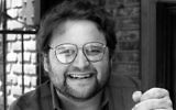 In this May 1986 file photo, actor Stephen Furst poses for a photo in Los Angeles (AP Photo/Lennox McLendon, File)