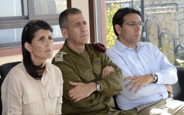 UN envoy Nikki Haley listens to a briefing from an IDF officer on the Lebanese border on June 8 2017 with Deputy IDF Chief Aviv Kochavi, center, and Israeli Ambassador to the UN Danny Danon (David Azagury/U.S. Embassy Tel Aviv)