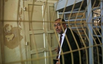 In this Monday, June 5, 2017 photo, the Mayor of Hebron Tayseer Abu Sneineh goes through an Israeli checkpoint to visit an Israeli controlled part of the West Bank city of Hebron. (AP/Nasser Shiyoukhi)