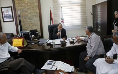 In this Monday, June 5, 2017 photo, the Mayor of Hebron Tayseer Abu Sneineh meets constituents at his office in the West Bank city of Hebron. (AP/Nasser Shiyoukhi)