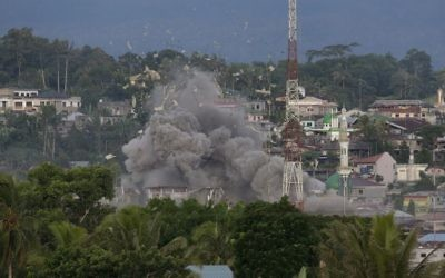 Debris fly as Philippine Air Force fighter jets bomb suspected locations of Muslim militants as fighting continues in Marawi city, southern Philippines, Friday, June 9, 2017.  (AP Photo/Aaron Favila)