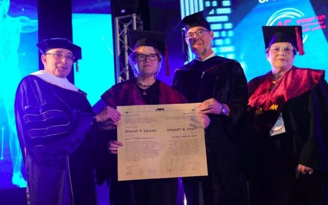 Prof. Deborah Lipstadt receives honorary doctor of philosophy degree from University of Haifa, June 6, 2017. Left to right: Prof. Ron Robin, President of the University of Haifa; Prof. Deborah E. Lipstadt; Prof. Gustavo Mesch, Rector of the University of Haifa; Ilana Livnat. (University of Haifa)