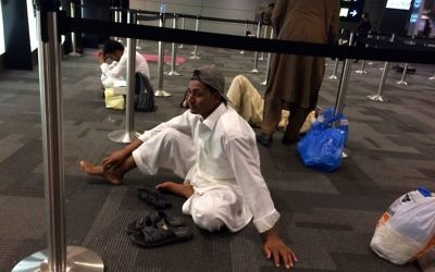 Passengers of cancelled flights wait in Hamad International Airport (HIA) in Doha, Qatar, Monday, June 5, 2017.  (AP Photo/Hadi Mizban)
