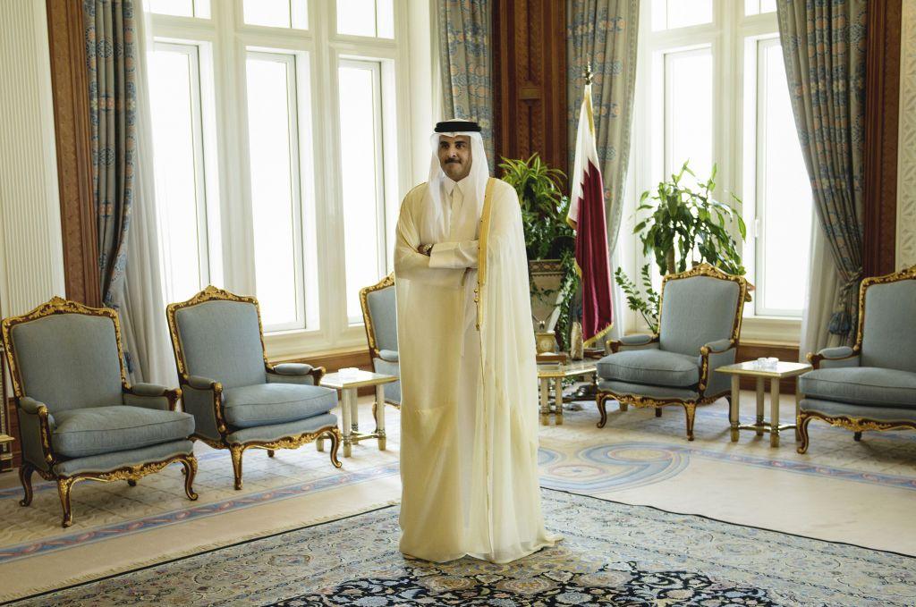 Qatar Emir Sheik Tamim bin Hamad Al-Thani waits for the arrival of U.S. Secretary of State John Kerry ahead of their meeting, at Diwan Palace in Doha, Qatar on August 3, 2015. (Brendan Smialowski/Pool via AP)