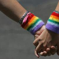 A lesbian couple hold hands during the annual Gay Pride rally, on June 8, 2007 Tel Aviv. (David Silverman/Getty Images via JTA)