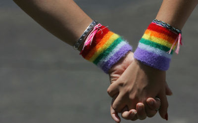 A lesbian couple hold hands during the annual Gay Pride rally, on June 8, 2007 Tel Aviv, (David Silverman/Getty Images via JTA)