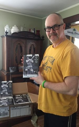 Ron Kaplan with his new book (Facebook)