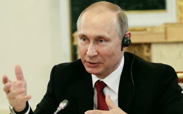 Russian President Vladimir Putin speaks at a meeting with heads of international news agencies at the St. Petersburg International Economic Forum in St. Petersburg, Russia, Thursday, June 1, 2017. (AP Photo/Dmitri Lovetsky, Pool)