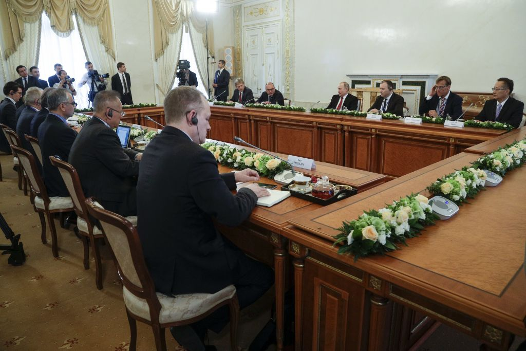 Russian President Vladimir Putin, fourth right in the back, meets with heads of international news agencies at the St. Petersburg International Economic Forum in St. Petersburg, Russia, Thursday, June 1, 2017. (AP Photo/Dmitri Lovetsky, Pool)
