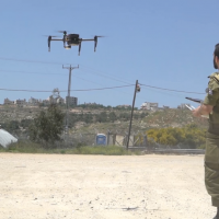 A soldier in the IDF's Combat Intelligence Corps operates a new drone purchased by the military for company commander. (Screen capture: Israel Defense Forces)